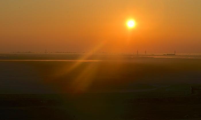Sonnenaufgang während der Passage durch den Suezkanal